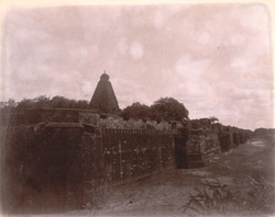 General view from south-east looking towards the main tower of the Brihadishvara Temple, with the fort wall and moat in the foreground, Thanjavur